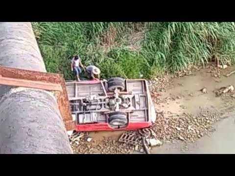 two dead after school bus falls off bridge