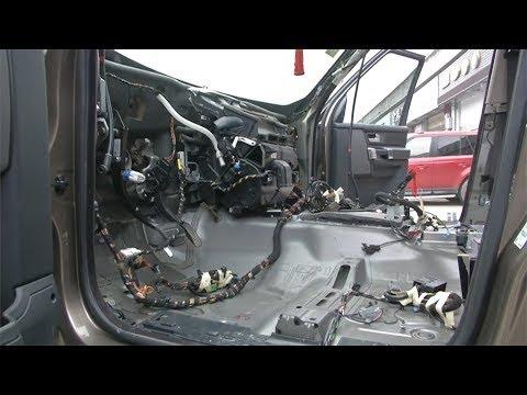 mechanics take apart a car to track down