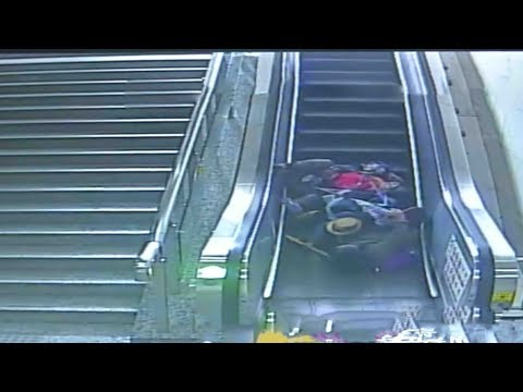 grandma mother baby fall down escalator