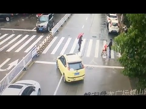 car blocks traffic to allow old woman