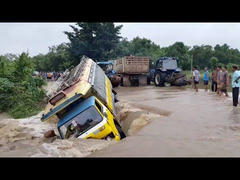 bus washes off road after flash flood