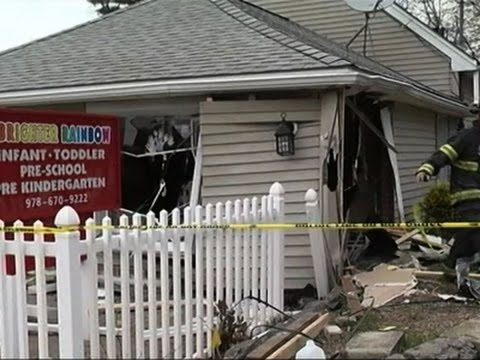 car crashes into mass day care center