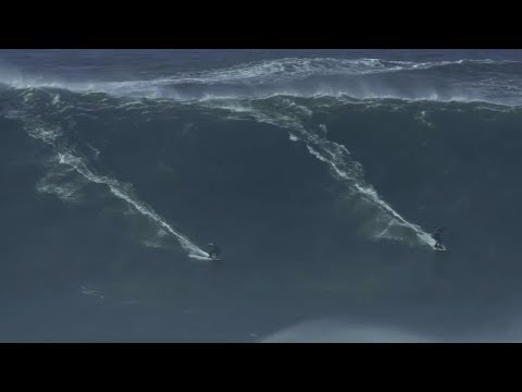 two surfers perform amazing double ride