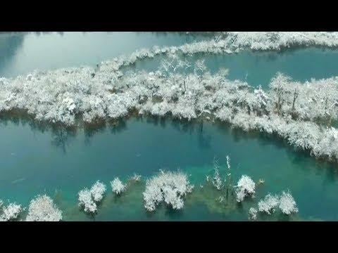 aerial footage shows snowy scenes